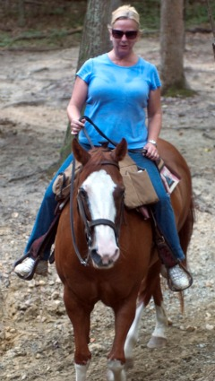 Lady Riding Sorrel Quarter Horse