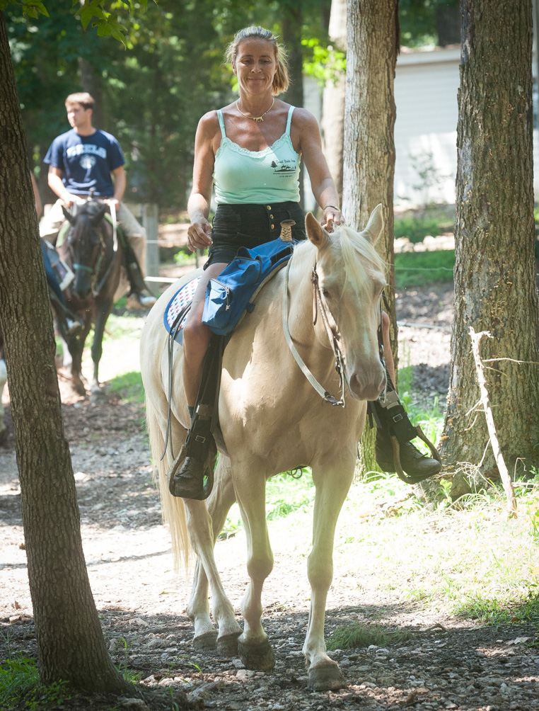 Woman Trail Riding Palomino